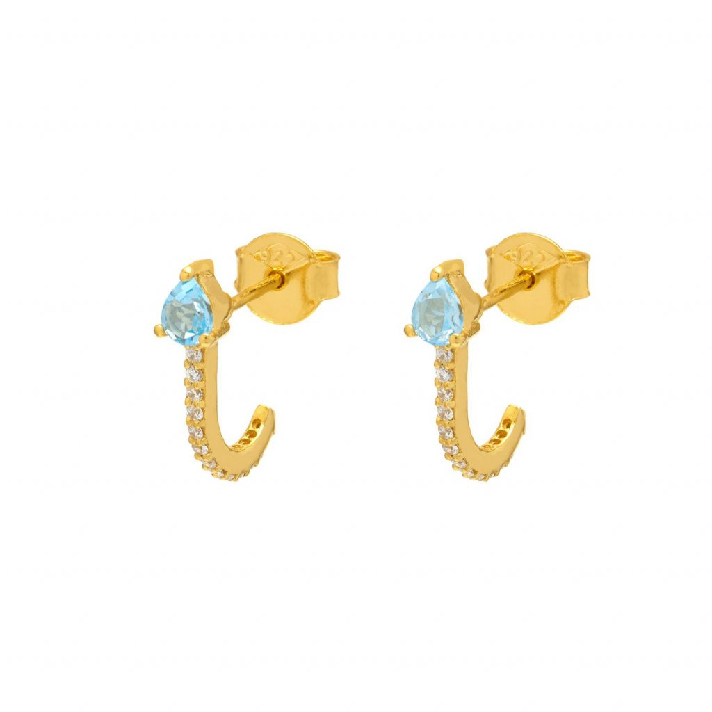 Blue Topaz Huggie Earrings by Assya